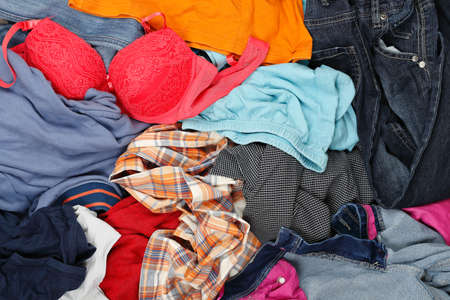 laundry pile: large variety of wrinkled clothes, full frame