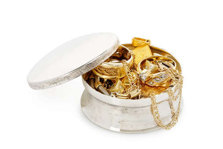silver jewelry box with a variety of jewelry isolated on white