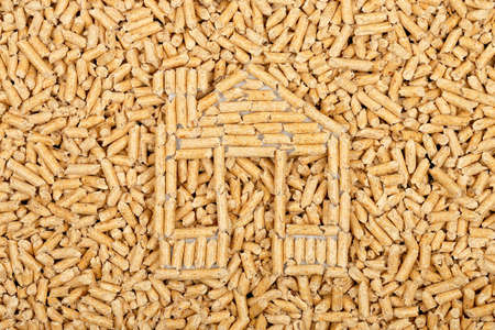 wood pellets: wood pellets in the shape of a house on wood pellets surface