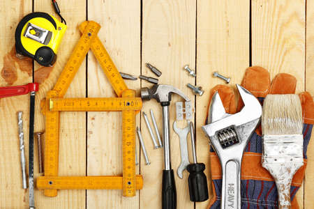 yardstick: yardstick as a house surrounded by a number of tools, home improvement or construction