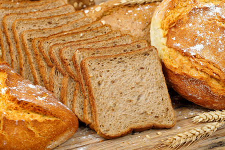 wholesome: wholesome sliced toast bread with traditional types of bread, full frame