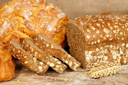 whole wheat: loaves of whole wheat bread on wooden surface