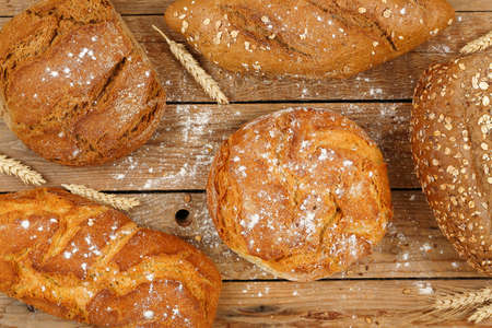 whole wheat: loaves of whole wheat bread on wooden surface, top view Stock Photo