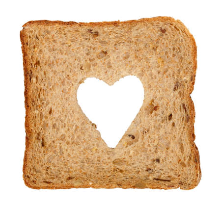 wheat toast: slice of whole wheat toast bread with heart shape isolated on white