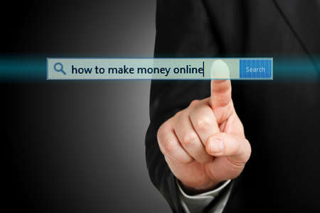 international money: male hand pressing a how to make money online search bar, internet and business concept