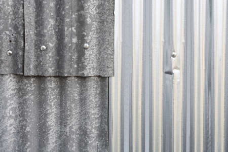 corrugated iron: overlapping corrugated iron sheets for backgrounds, full frame