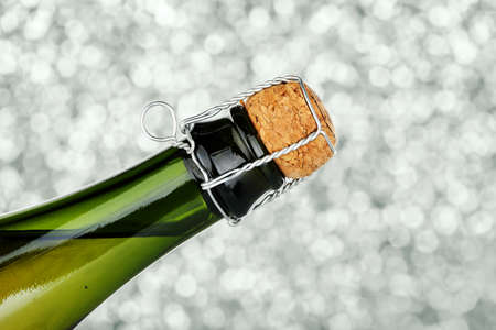 against abstract: closeup of champagne bottle with cork against abstract background