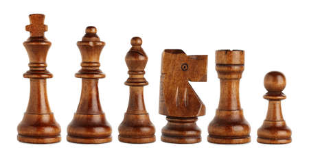 pawn to king: set of brown wooden chess pieces isolated
