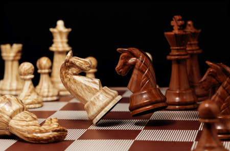 aggresive: brown knight is attacking the white one, high speed image Stock Photo
