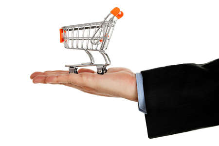 hand with shopping cart isolated on white photo