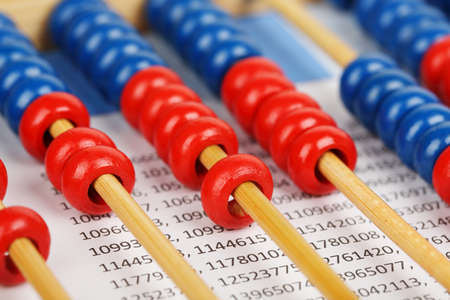 macros: closeup of a blue and red abacus on sheet with numbers Stock Photo
