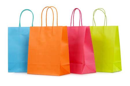 白で隔離 4 カラフルなショッピング バッグのクローズ アップ