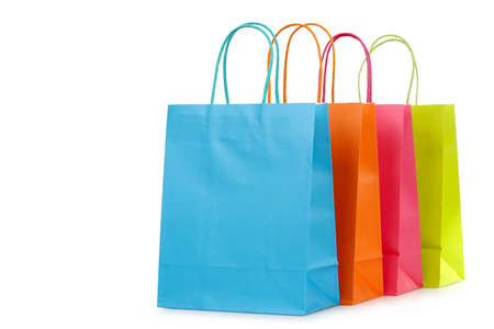 four colorful shopping bags closeup isolated on white