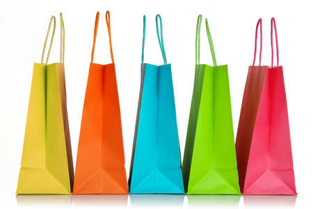 gift bags: five colorful shopping bags closeup isolated on white