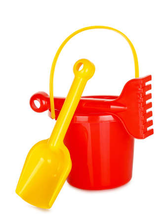 bucket and spade: plastic bucket, spade and rake isolated on white