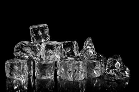 chilled: ice cubes with reflection on black background Stock Photo