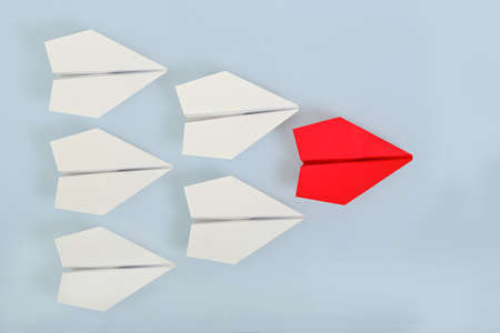 ones: red paper plane leading white ones, leadership concept Stock Photo