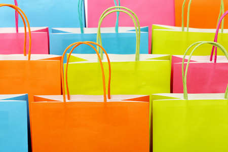 or spree: close up of colorful paper shopping bags