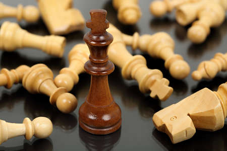 opponents: brown chess king surrounded by fallen opponents
