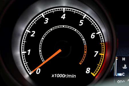 tachometer: closeup of modern illuminated tachometer on black