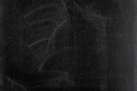 distressed texture: rubbed out chalk on black chalkboard Stock Photo