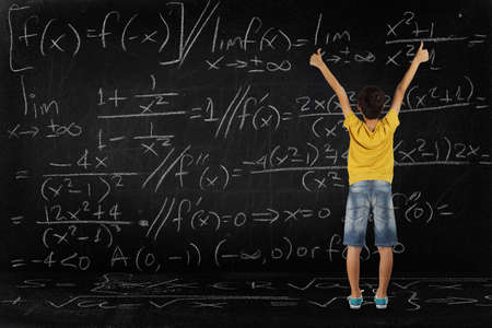 equation: happy student after having solved a difficult equation, school concept