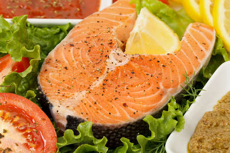fish: closeup of raw salmon on dish with other ingredients