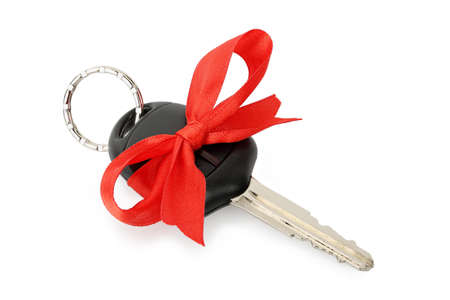 car lock: car key with ribbon isolated on white