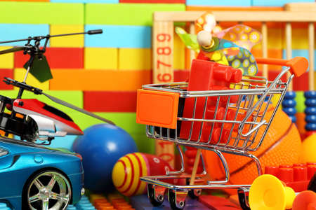 brick: shopping trolley with a number of toys Stock Photo