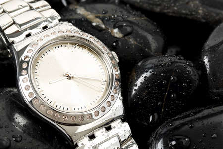 luxurious: luxurious chrome watch on black stones with waterdrops Stock Photo