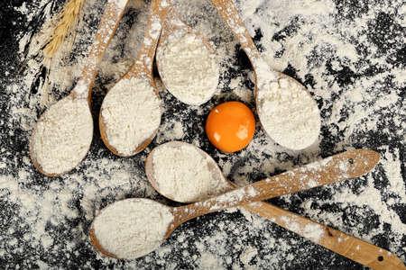 ladles: ladles with flour around an egg yolk, baking concept