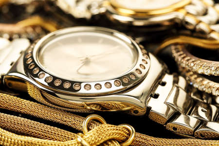 luxurious: luxurious chrome watch with other pieces of jewelry Stock Photo