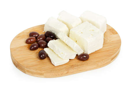 feta cheese: sliced feta cheese with olives on wooden board isolated Stock Photo