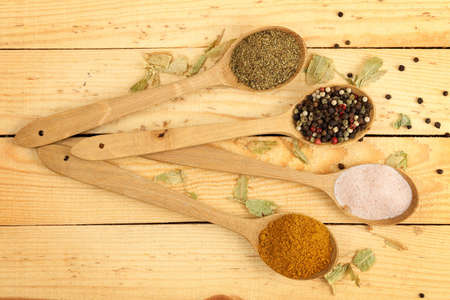 ladles: ladles with pepper, curry, oregano and himalayan salt