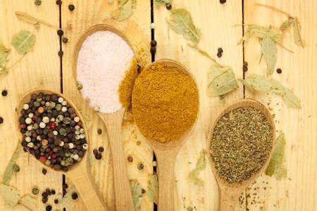 himalayan salt: ladles with pepper, curry, oregano and himalayan salt