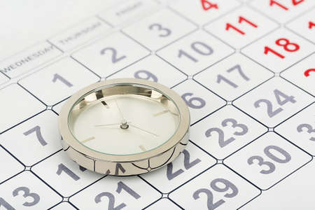 abstract time: chrome clock on calendar, abstract time concept