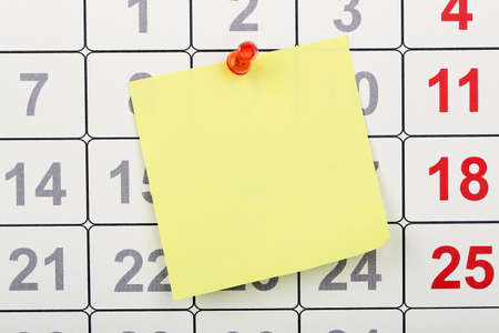 closeup of blank note pinned on calendar Stock Photo