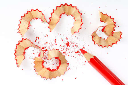sharpened: sharpened red pencil with shavings on white paper