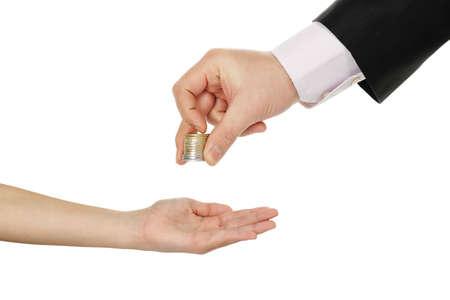 bolsa dinero: adulto que provee monedas para un niño aislado en blanco