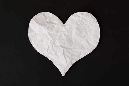 heart white: white crumpled paper love heart on black