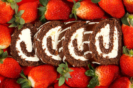 chocolate cake: sliced chocolate cake roll with fresh strawberries Stock Photo