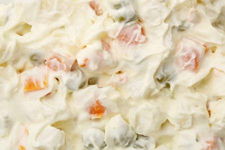 ensaladilla rusa: primer plano de ensalada rusa para el uso del fondo Foto de archivo