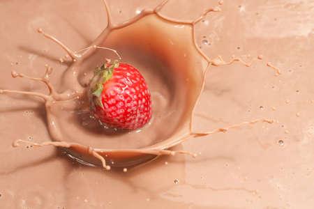 strawberry chocolate: strawberry splashing into chocolate milk Stock Photo
