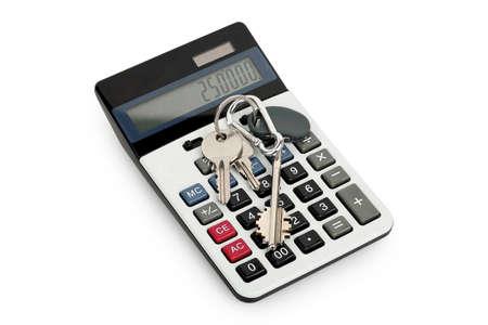 keys isolated: house keys on calculator isolated on white Stock Photo