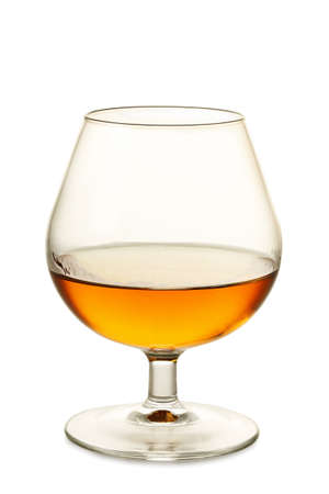 cognac: single glass of cognac isolated on white