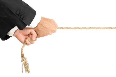 business rival: businessman pulling a rope isolated on white Stock Photo