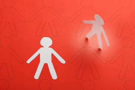 the chosen one: cutout paper person having been chosen among other candidates, business or social concept Stock Photo