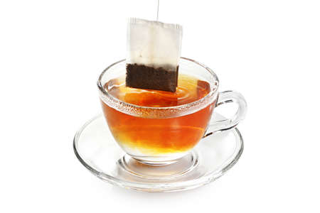 cup of tea: tea bag in transparent cup of tea isolated Stock Photo