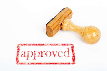office rubber stamp with approved stamp on white paper