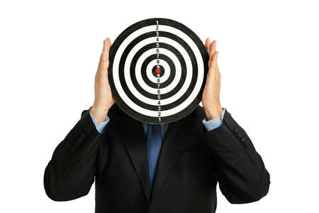 tolerate: businessman holding a dartboard, abstract business concept